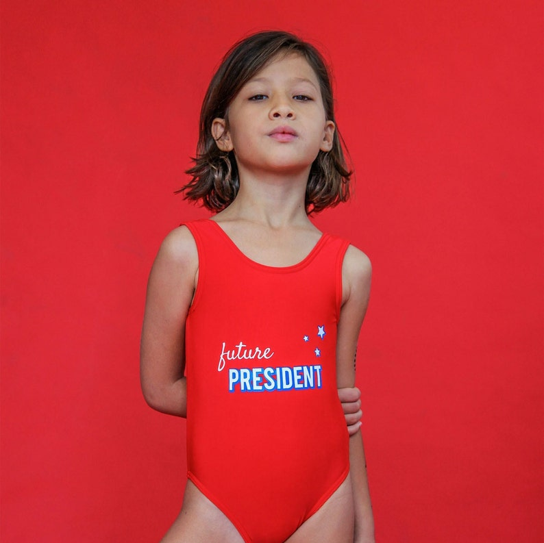 a50e7f4a04 Girls Red Future president one piece bathing suit | Etsy