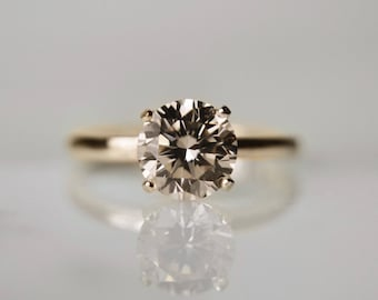 1 Carat (7mm) Round Brilliant in Light Champagne - Handcut Diamond Simulant in 4-prong 14kt Yellow Gold Ring