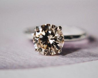 1 Carat (7 millimeter) Round Brilliant in Light Champagne - Handcut Diamond Simulant in 4-prong Sterling Silver Ring