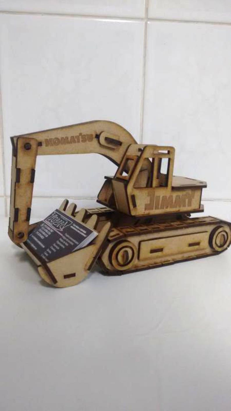 excavator. vector drawing of a wooden toy 3d puzzle game.diy.souvenir  ,wood, wooden, vector graphics,laser. cnc router and laser cutting.