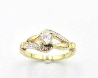 Women's ring in solitary yellow gold gold imitation diamond and volutes T 53.5
