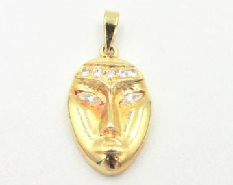 Mask pendant African mask inspiration gold plated and white stones imitation diamonds