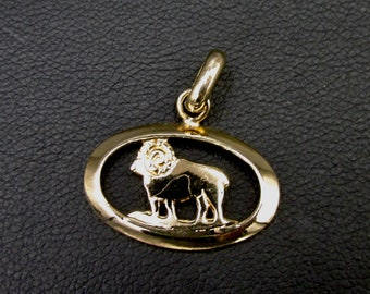 Pendant astrological sign in gold plated sign of the ram opened .