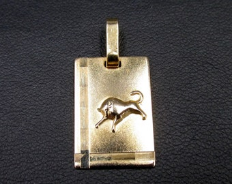 pendant astrological sign in gold plated sign of the bull , rectangular medal