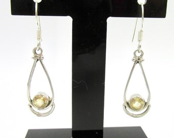 Vintage earrings dangling in silver 925 and stone imitation topaz or citrine color champagne
