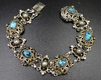 Beautiful bracelet dating from the 19th century, Austro-Hongroise origin made of silver 800 vermeil set with turquoises and pearls