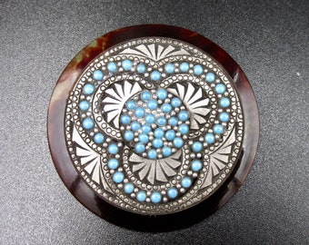 Vintage brooch in art deco style in amber coloured plastic with silver inlay of Turquoise motifs and cabochons