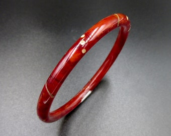 Vintage art deco vintage junk bracelet in marbled cherry cherry red bakelite set with white rhinestones