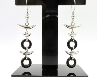 Long tribal ethnic style earrings dangling in silver 925 and black ceramic circles minimal style style