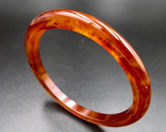 Vintage end Bangle in bakelite color amber Apple juice, transparent Orange swirl