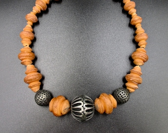 Beautiful vintage necklace with ethnic style in hand-crafted terracotta beads and hollow metal beads