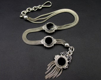 Superb Victorian-era chatelaine dating from the 19th century French origin, in silver and jet.