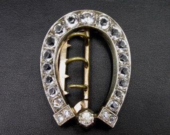 Old belt buckle in early 20th century silver brass and set with rhinestones, white crystal