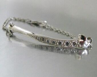 Precious bone skeleton bracelet in solid silver and white zirconium oxides unique piece Flora Guigal