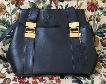 Beautiful vintage handbag worn with JOOP! smooth navy blue leather and gold metal elements