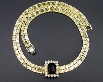 Vintage chain neck necklace articulated in gold metal white and black rhinestones.