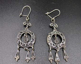 Dangling earrings with an ethnic silver style, watermark décor and charms