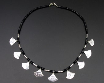 Touareg neck collar in black glass beads and chiseled silver