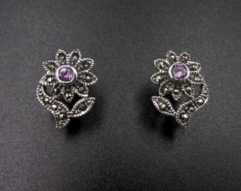 Pretty vintage 925 silver earrings and marcassites representing flowers in the heart of amethysts