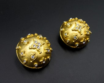 Large vintage clip earrings by Vanecci, half gold-colored spheres set with white rhinestones