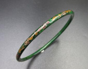 Chinese junk bracelet in partitioned enamel floral decoration on olive green background