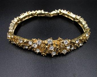 Vintage women's fancy bracelet signed MB in gold metal and white rhinestones 21 cm