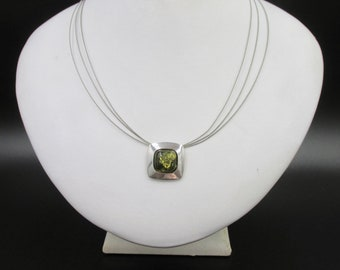 Low neck necklace with minimal silver style 925 square pendant set with a square of green amber