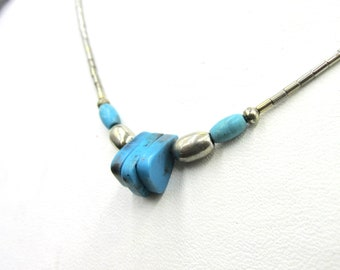 Pretty little fancy neck necklace with Indian ethnic style in silver metal decorated with turquoise imitation beads