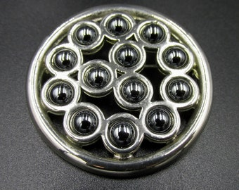 Haute couture jewel brooch by Paco Rabanne grey chrome metal and hematite-coloured grey cabochons.