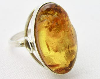 Silver ring 925 and oval amber cabochon from Russia T 55/56