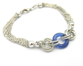 Silver woman bracelet 925 multi-row chains and patterned intertwined rings blue glass ring 18 cm