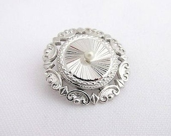 Old round chiseled brooch and white silver pearl