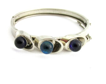 Vintage 70s-style bracelet in silver metal and blue-highlighted glass balls