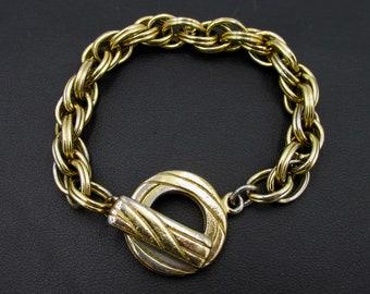 Vintage gold metal women's bracelet by Orena Paris chain and stick clasp