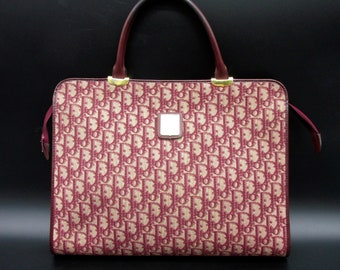 Dior vintage monogram burgundy monogram bag in woven canvas and 70s leather carries documents