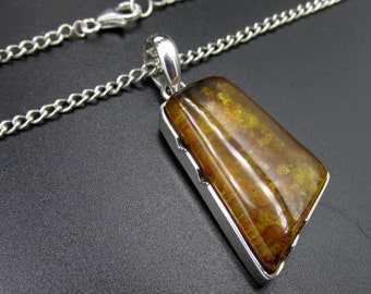 Woman's necklace made of 925 silver with her pendant set with amber, originally from Poland