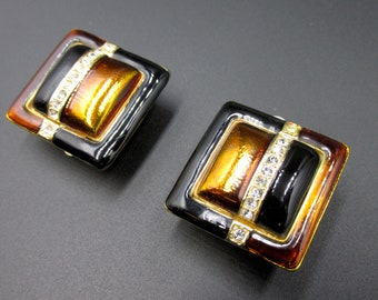 Vintage clip earrings signed in square enamelled orange brown color set with rhinestones