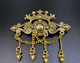 Fancy faux brooch style vintage fleur de lis signed counters the ice with pendants on chains in golden metal