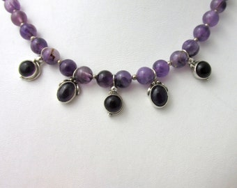 Ethnic necklace made of smooth Amethyst beads and Amethyst cabochons set on silk 45 cm silver