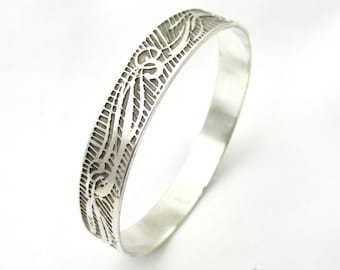 Beautiful handmade Bangle made from silver plated brass decorated with scrollwork signed Oloe