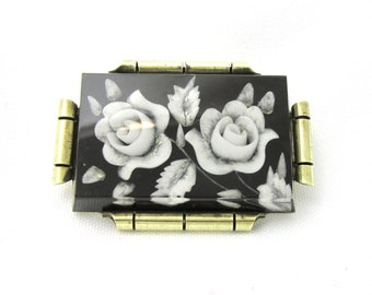 Vintage black and white vintage brooch art deco brass and carved plastic resin decorated with floral patterns: Roses
