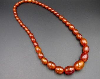 Vintage olive pearl necklace in transparent amber bakelite