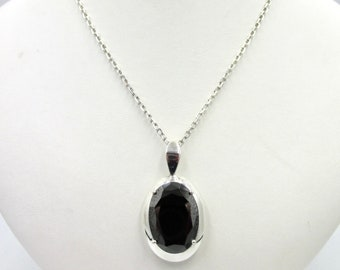 Beautiful Locket necklace in Sterling Silver set with a black onyx stone is faceted on large mesh convict diamond chain.