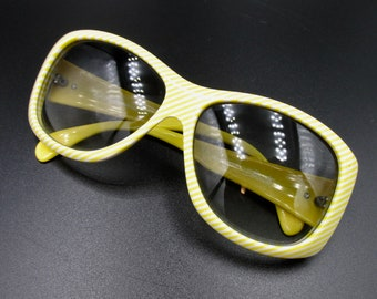 Vintage sunglasses from the Austrian brand silhouette striped yellow and white MOD 3025