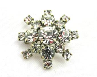 Fancy vintage metal brooch and sun-shaped rhinestones