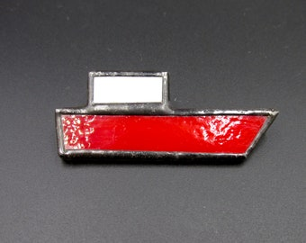 Vintage stained glass brooch depicting a red and white boat, glass and tin