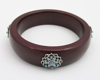 Burgundy bracelet and silver metal and turquoise insert