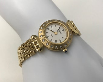 Vintage 14K Gold GENEVE WATCH with 20 Diamonds .60 Carats Weighs 39.0 Grams