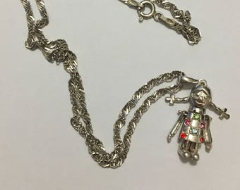Articulated Doll Pendant with Silver Necklace