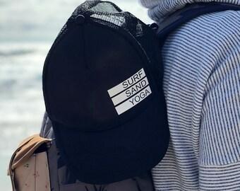 Surf Sand Yoga Black Foam Trucker Hat.